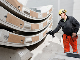 Worker scanning concrete segments